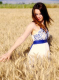 Sweet woman on wheat. Sweet young woman on yellow wheat Royalty Free Stock Image