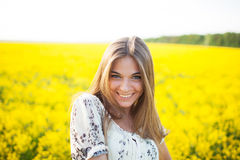 Sweet woman among yellow wildflowers in summer Royalty Free Stock Photography