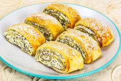 Sweet yeast rolls with cheese and poppy seeds Royalty Free Stock Photos
