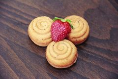 Sweet yellow biscuit cakes shells with strawberry decor royalty free stock photography