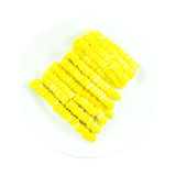 Sweet yellow corn slice ingredient on white plate Royalty Free Stock Photos
