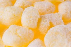 Sweet yellow corn sticks with powdered sugar texture, background, closeup. Sweet yellow corn sticks with powdered sugar texture, background, closeup Royalty Free Stock Photography