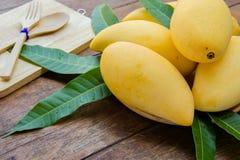 Sweet yellow mango fruit on summer on wood table.  Stock Photography