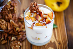 Sweet yogurt with baked quince Royalty Free Stock Photography