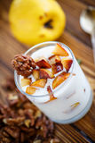 Sweet yogurt with baked quince Royalty Free Stock Images
