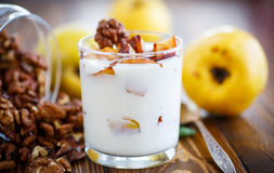 Sweet yogurt with baked quince Royalty Free Stock Photo