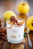 Sweet yogurt with baked quince Stock Image