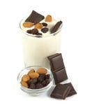 Sweet yogurt desert with chocolate, almonds and raisins Stock Photo