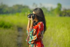 Sweet young Asian Chinese or Korean woman on her 20s taking picture with photo camera smiling happy in beautiful nature landscape. Sweet young Asian Chinese or Royalty Free Stock Photography