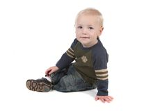 Sweet Young Baby Boy Sitting Sideways Stock Image