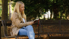Sweet young blond women. Sweet young blond woman writing in her diary Stock Photography