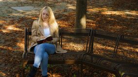 Sweet young blond women. Sweet young blond woman writing in her diary royalty free stock photography