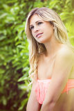 Sweet young blonde girl smiling and looking. Swimsuit Royalty Free Stock Image