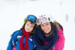 Sweet young boy and his mother, learning to ski on a mild ski sl Stock Photo