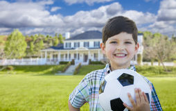 Sweet Young Boy Holding Soccer Ball In Front of House Royalty Free Stock Photography