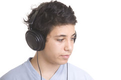 sweet young boy listening to music on headphones Stock Photography