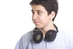 Sweet young boy listening to music on headphones Royalty Free Stock Photography