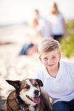 Sweet Young Boy Playing with His Dog Royalty Free Stock Images