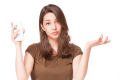 Sweet young brunette using mobile phone. Royalty Free Stock Images