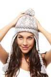 Sweet young brunette woman wearing winter cap hold Royalty Free Stock Image