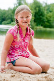 Sweet young child in the sand Royalty Free Stock Photos