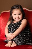 Sweet Young Child Sitting in a Chair stock image