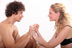Sweet young couple. Young couple holding each other hands Royalty Free Stock Photos
