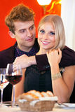 Sweet Young Couple Dating at Restaurant Royalty Free Stock Photography