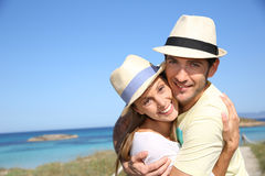 Sweet young couple embracing on their trip Stock Photos