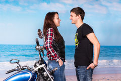 Sweet Young Couple Facing Each Other at the Beach Royalty Free Stock Images