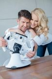 Sweet Young Couple Having Fun with Cool Gadget Royalty Free Stock Photos
