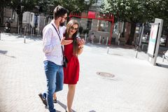 SWEET YOUNG COUPLE IN LOVE. Attractive Young Couple In Love walking in the city on a sunny day Stock Photos