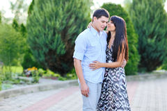 Sweet young couple in a park Stock Photos