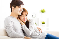 Sweet young couple sitting in sofa Stock Photo