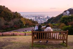 young couple see Kobe skyline at twilight Stock Photos