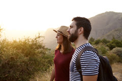 Sweet young couple surrounded by mountains Stock Photo