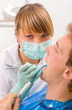 Sweet young dentist. Young man at the sweet dentist Royalty Free Stock Images