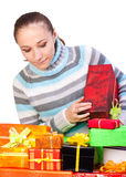 Sweet young girl with christmas present Royalty Free Stock Images