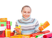 Sweet young girl with christmas present Stock Photos