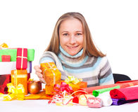 Sweet young girl with christmas present Royalty Free Stock Image