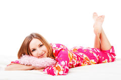 Sweet Young Girl In Pink Pajamas On Bed Royalty Free Stock Image