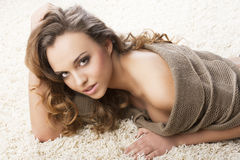 Sweet young girl laying on carpet Stock Photography