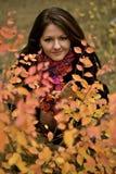 Sweet young girl and nice bush Royalty Free Stock Image