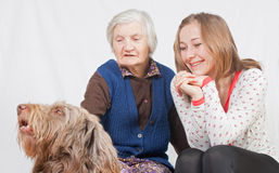 The sweet young girl and the old woman. Old woman and the sweet young girl Royalty Free Stock Photo