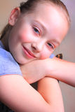 Sweet Young Girl. A smile on a little blond cutie 9 year old girl. Shallow depth of field Royalty Free Stock Image