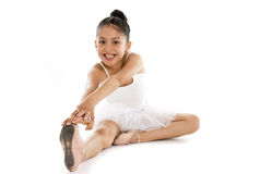 Sweet young little cute ballet dancer girl stretching on the floor Royalty Free Stock Image