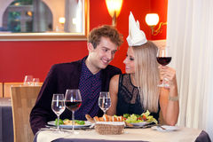 Sweet Young Lovers Having Dinner at Restaurant. Stock Images