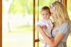 Sweet young mother and adorable little son Stock Photos