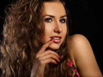Sweet young woman on black background Stock Images
