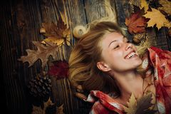Free Sweet Young Woman Playing With Leaves And Looks Very Sensually. Sensual Woman Wearing Pullover, Looking At Camera Royalty Free Stock Photography - 129231537